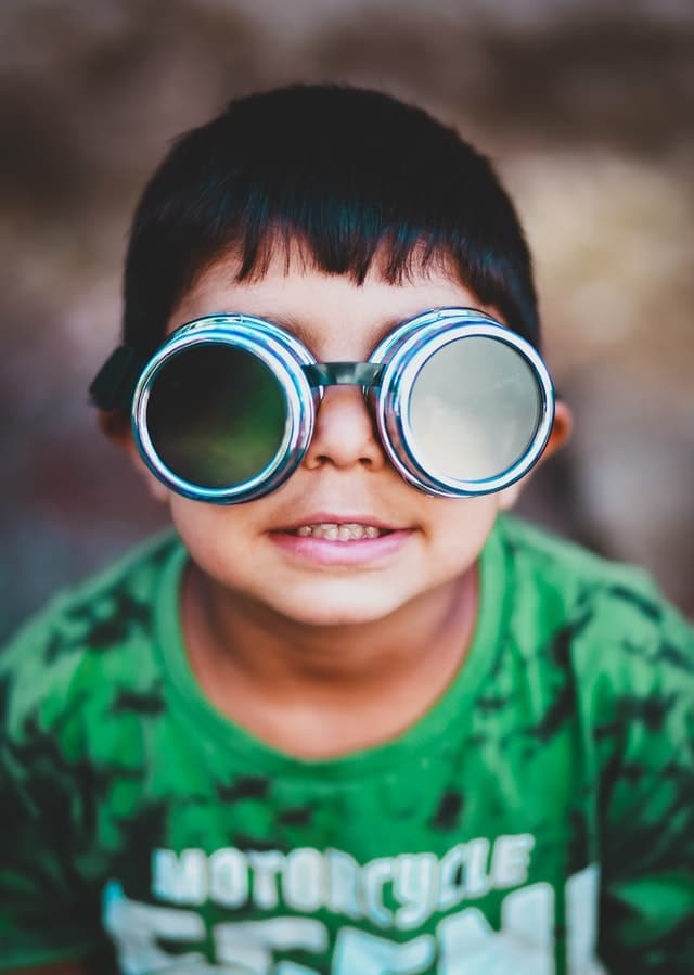 child wearing pilot goggles
