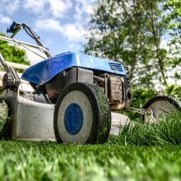 Close up of a lawnmower mowing a lawn