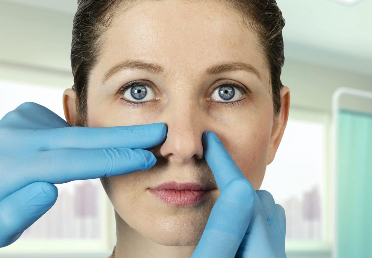 Woman being examined for nasal surgery