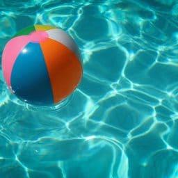 A beach ball in a pool.